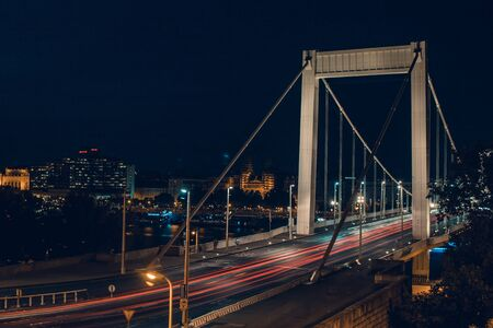 Night time traffic over the Elisabeth bridge. It crosses Danube river and connect Buda and Pest together. Budapest, Hungary.