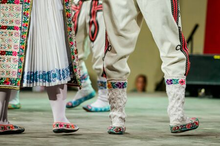 Close up of wool socks on legs of young Romanian dancer in traditional folkloric costume. Folklore of Romania