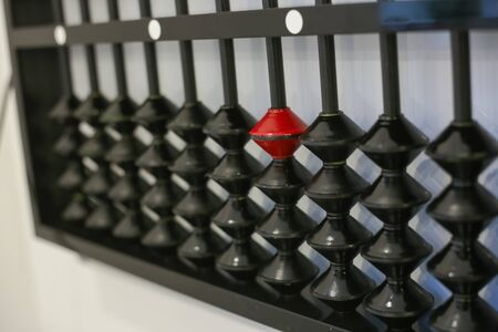 antique wooden black abacus isolated in classroom