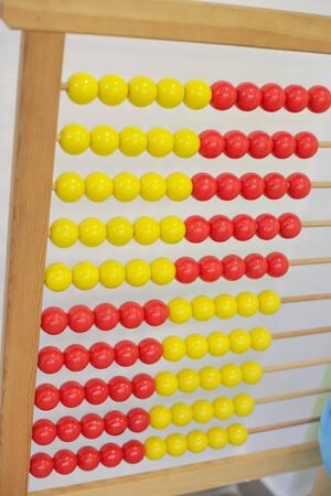 antique wooden red and yellow abacus isolated in classroom Imagens