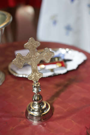 Gold cross for christening in the orthodox church. Church attributes.