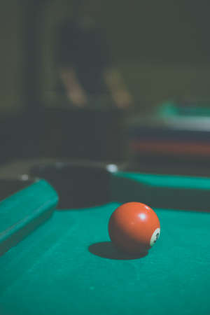 Red, number 3, billiard ball in a pool table. Vintage style noise effect