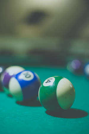 Billiard balls in a pool table. Vintage style noise effect