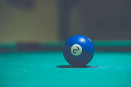 Blue, number 2, billiard ball in a pool table. Vintage style noise effect 版權商用圖片