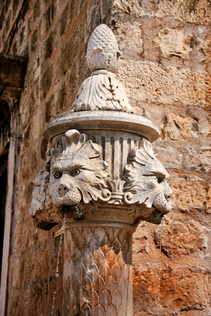 Fountain of serious lion in old town of Dubrovnik, Croatia. old medieval street statue fountain, close up. Stock Photo