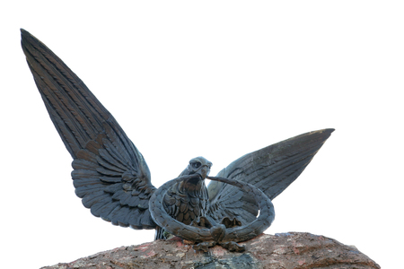 Statue of eagle. Statue of mighty eagle carrying a circle in his beak. Stock Photo