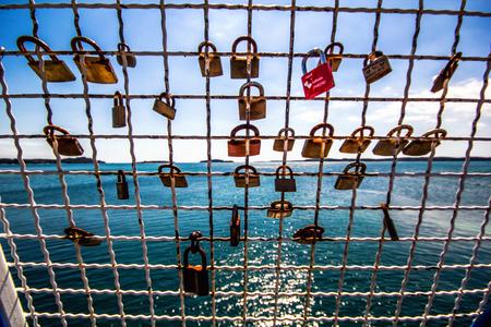 Padlocks of love with a sea view, Lock love Stock Photo