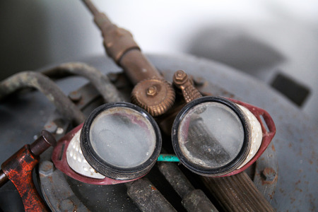 Old protective goggles for welding and grinding Stock Photo