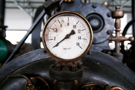 Vacuum gauge at the mechanical machines, close-up