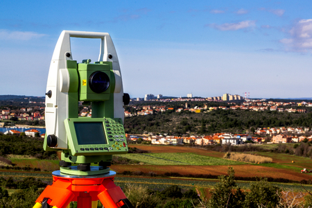 Fall time land surveying, total station set in the field Reklamní fotografie - 79057973
