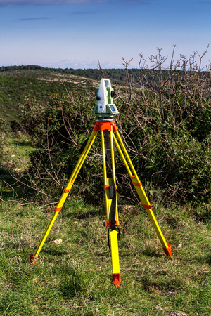 Fall time land surveying, total station set in the field Stock Photo