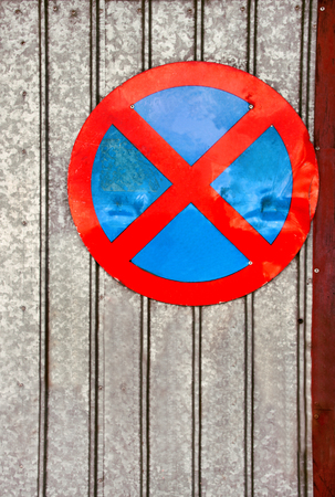 enforce: No parking traffic sign over old iron background Stock Photo