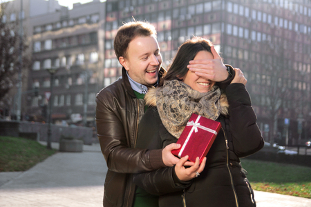 Amorous young man wants to surprise the girl with a gift for Valentine Day.