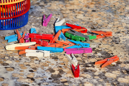 Clothespins. Colorful plastic clothespins, stand on the table. Cloth clothespins.