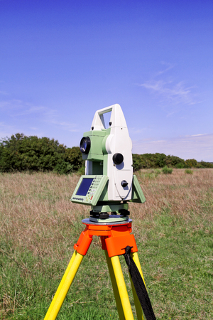Total station. Survey Instrument geodetic device. Fall time land surveying, total station set in the field. 写真素材