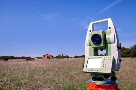 Total station. Survey Instrument geodetic device. Fall time land surveying, total station set in the field. Stock Photo