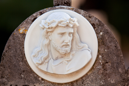 Vintage tombstones marble monument in old city cemetery, close up. Sculpture art. Stock Photo