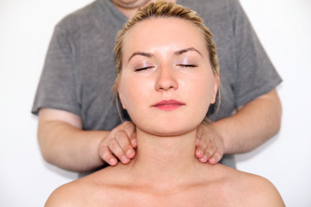 Massage relax studio. Woman having her neck massaged. Massage therapist massaging neck muscles. Body care. Beautiful young woman relaxing with hand massage at beauty body spa.