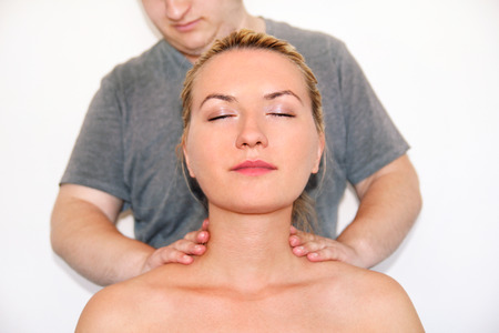 Massage relax studio. Woman having her neck massaged by a physiotherapist. Massage therapist massaging neck muscles. Body care. Beautiful young girl relaxing with hand massage at beauty body spa.