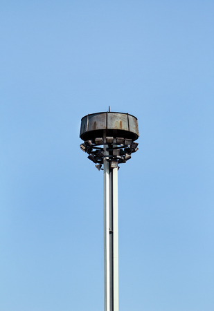 Tower with reflectors at the roundabout on the city road and street. Lighting pole with & Stadium Floodlight Tower With Reflectors With Blue Sky. Lighting ... azcodes.com