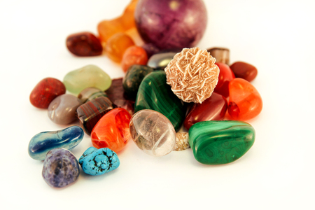 Semi precious stones  Crystal Stone Types  healing stones, worry stones, palm stones, ponder stones  Various stones gemstones background texture  Heap of various colored gems mineral collection. Stock Photo