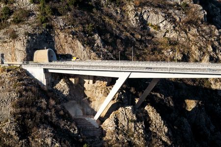 Scenic view on motorway tunnel and bridge highway road leading through in Croatia, Europe / Transport and traffic infrastructure / Signs and signaling. Imagens