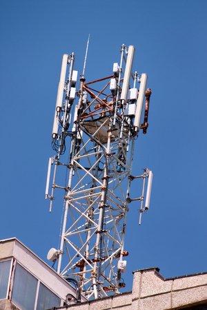 Telecommunication base stations network repeaters on the roof of building. Фото со стока