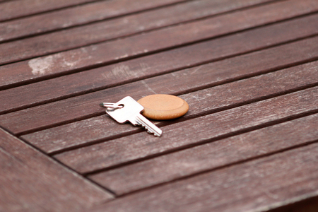 Hotel suite key with wooden fob for room on wood table.