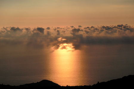 Sea, sky, beautiful structure of clouds, majestic landscape with seascape at calm sunset on horizon of mediterranean coast. Stock Photo