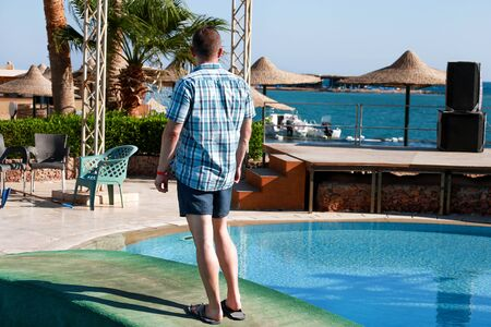 Portrait of tourist and traveler is posing and watching on beautiful beach of hotel resort in Egypt Stock Photo