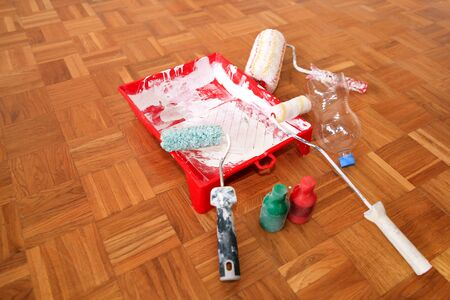 Wall painting equipment, tools and mess.