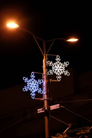 Christmas blue and white lights simulating shape of frozen snowflakes.