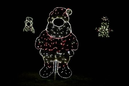 Christmas red and white night lights simulating shape of frozen snowman. Reklamní fotografie
