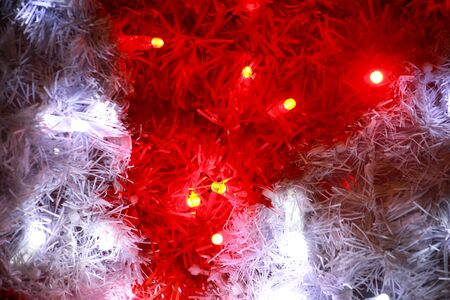 Part of Christmas decorative red and white flashing lights, close up.