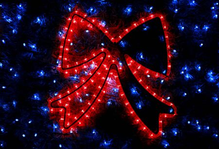 Part of Christmas tree decorations blue flashing lights. Reklamní fotografie - 135465948