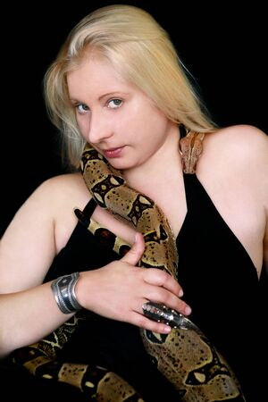 Portrait of girl with Boa constrictor snake.