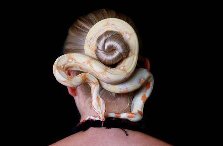 Snake on female head.