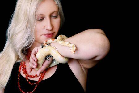 Portrait of girl with Boa constrictor albino snake. Reklamní fotografie