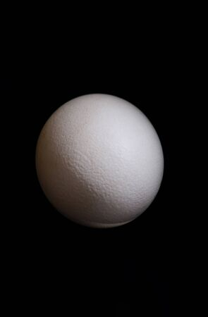 Big ostrich egg isolated on a black Stock Photo