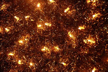 Part of Christmas decorative yellow and white flashing lights, close up. Reklamní fotografie