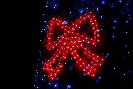 Part of Christmas tree decorations blue flashing lights. Stock Photo