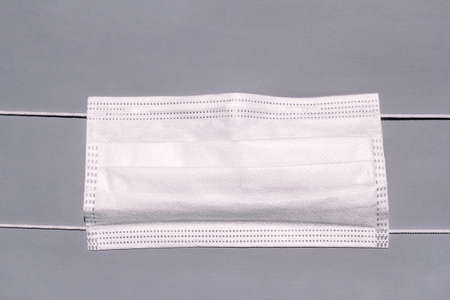 Medical protective white mask activated carbon disposable fiber face. Face mask protection against virus, flu and coronavirus (COVID-19), bacterial and germs. Health care and surgical concept.