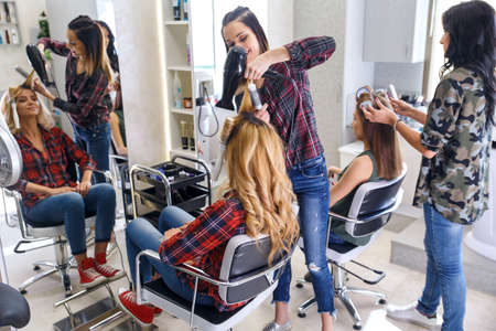 Working day inside the hair salon.
