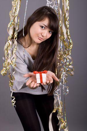 Girl standing among tinsel Stock Photo - 6835518