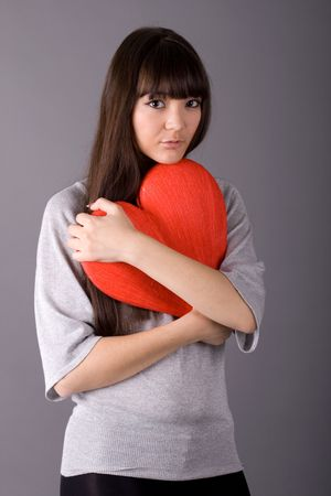 Beautiful woman holding red heart Stock Photo - 6835515