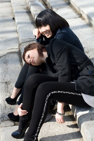 Two female friends walking outdoor  photo
