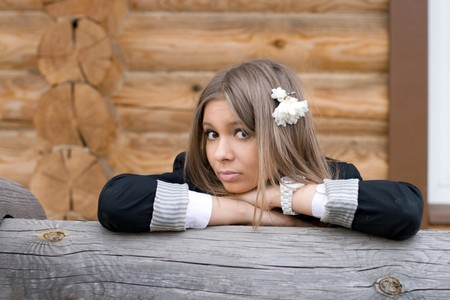 Girl  in front of a wooden house Stock Photo - 6952019