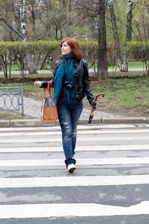 Girl crossing the street Stock Photo