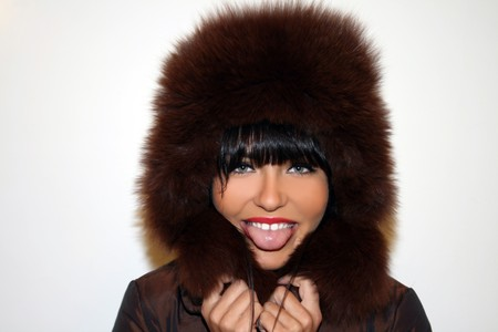 Portrait of a pretty young woman in a furry hat photo