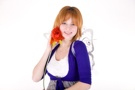 Smiling girl with a flower photo